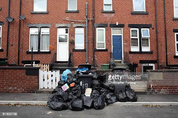 Overflowing refuse bins litter the streets in the Beeston area of Leeds on October 1, 2009 in Leeds, England. A strike by bin men in Leeds is now...