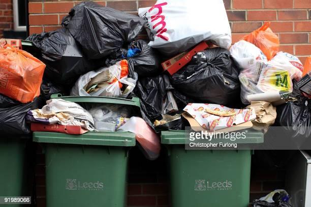 Overflowing refuse bins litter the streets in the Headingley area of Leeds on October 19, 2009 in Leeds, England. A strike by bin men in Leeds is now...