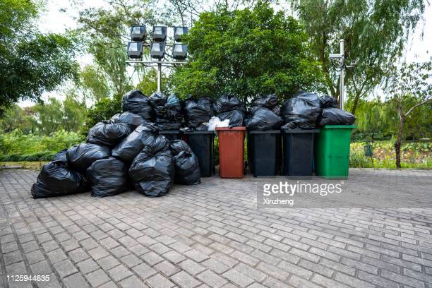 overflowing wheelie bin - overflowing stock pictures, royalty-free photos & images