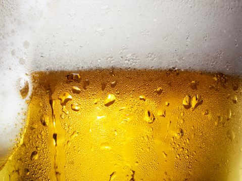 Overfull Glass of Beer with Condensation - gettyimageskorea