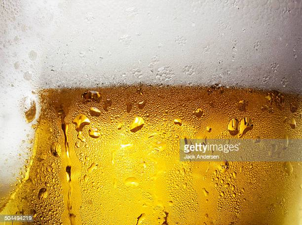 overfull glass of beer with condensation - cold temperature stock pictures, royalty-free photos & images
