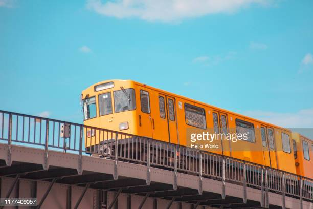 overground subway train on a blue sky background - berlin stock pictures, royalty-free photos & images