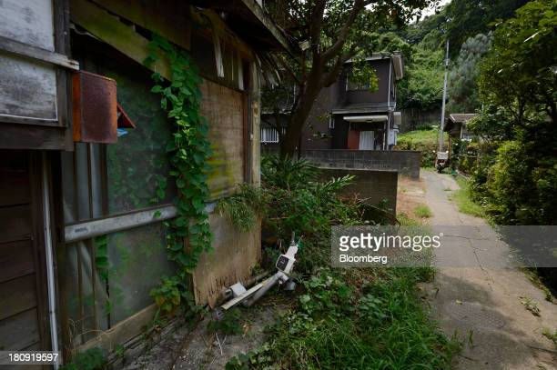 Overgrown vegetation surrounds a vacant house in the Yato area of Yokosuka City Kanagawa Prefecture Japan on Wednesday Aug 21 2013 More than 50...