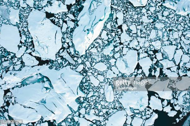 overhead aerial shot of ice floes in beautiful blue color shot in iceland in winter - polar climate stock pictures, royalty-free photos & images