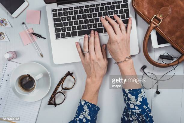 Overhead Business Angles woman at office desk