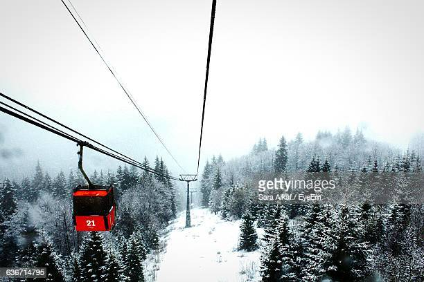 Overhead Cable Car At Snow Covered Field