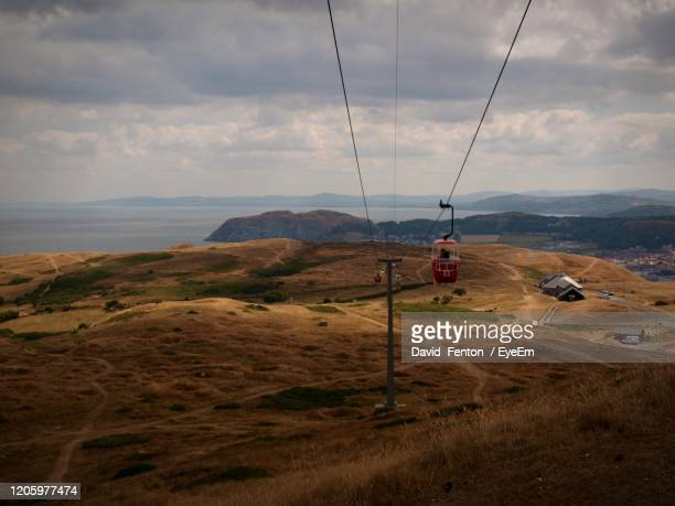 overhead cable car on land against sky - llandudno wales stock pictures, royalty-free photos & images