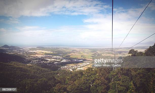 Overhead Cable Car Over Mountain Against Cloudy Sky