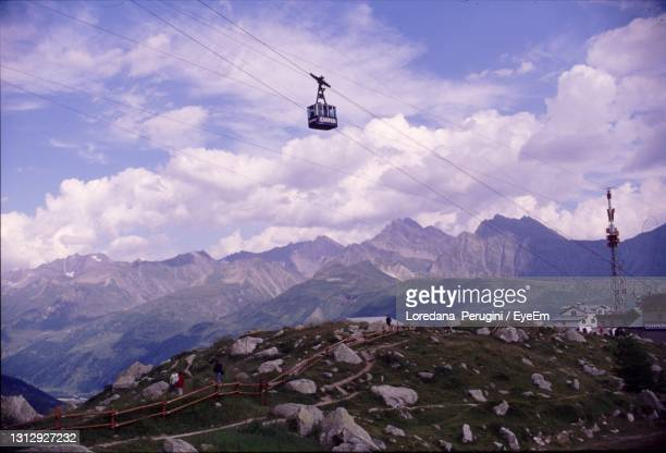 overhead cable car over mountains against sky - loredana perugini stock pictures, royalty-free photos & images