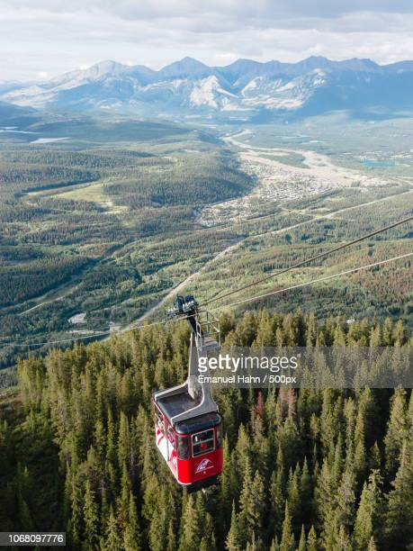 overhead cable car over wilderness, calgary, canada - banff stock photos and pictures