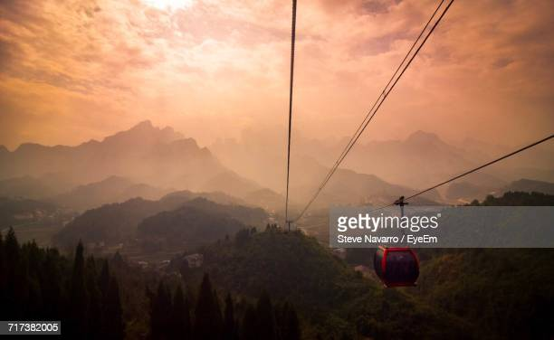 overhead cable cars over mountains against sky - tianmen stock pictures, royalty-free photos & images