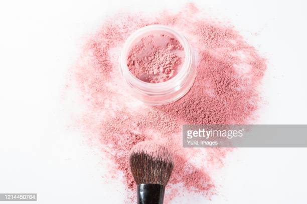 overhead close up of one open jar of spilled pink blush powder - 白粉 ストックフォトと画像