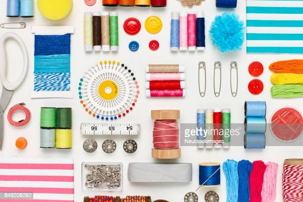 overhead flat lay of various sewing items on white background - sewing stock pictures, royalty-free photos & images