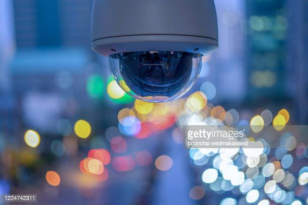 cctv overhead for security on the road or in town and with soft car and building background. - business security camera stock pictures, royalty-free photos & images