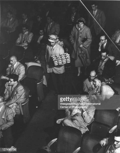 Overhead infrared view of a movie theater audience New York New York mid 20th century Photo by Weegee/International Center of Photography/Getty Images
