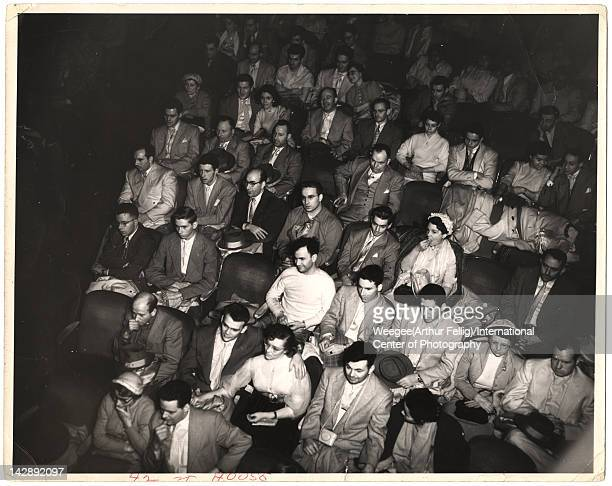 Overhead infrared view of the audience at a 42nd Street movie theater audience New York New York mid 20th century Photo by Weegee/International...