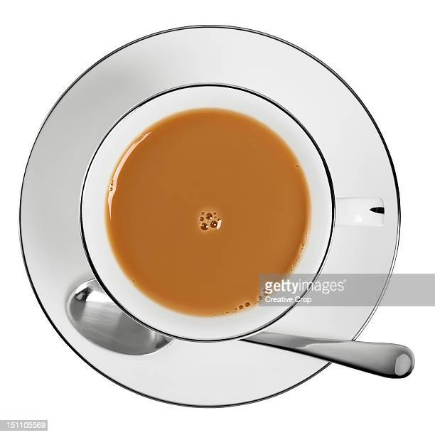 overhead of a cup of tea - saucer stock pictures, royalty-free photos & images