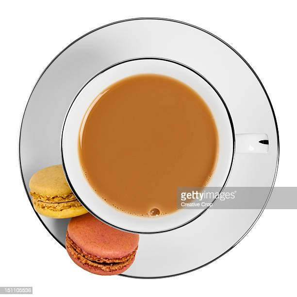 Overhead of a cup of tea with macaroons