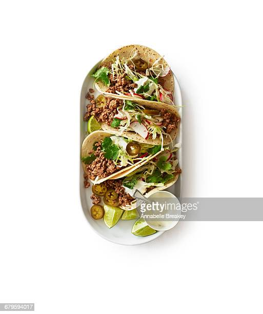 Overhead of beef taco plate on white