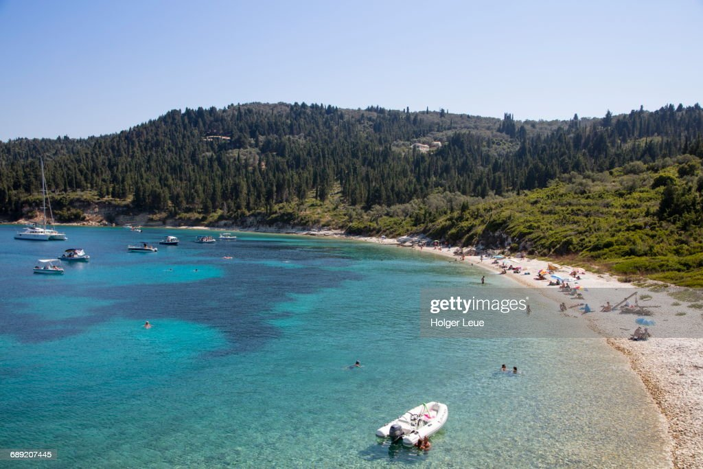 Overhead of boats and people relaxing on beach : Stock Photo
