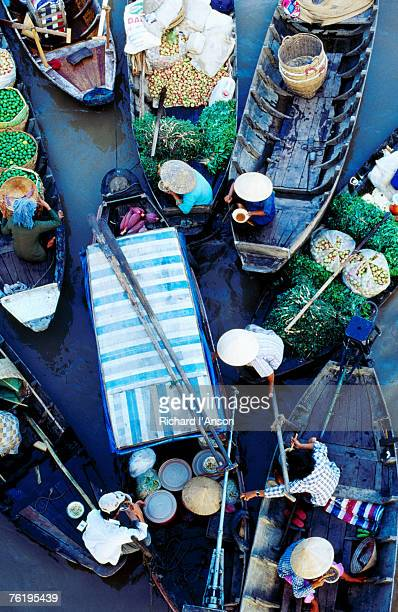 Overhead of boats at floating market, Vietnam, South-East Asia