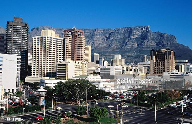 overhead of city office towers with table mountain in background. - table mountain stock pictures, royalty-free photos & images