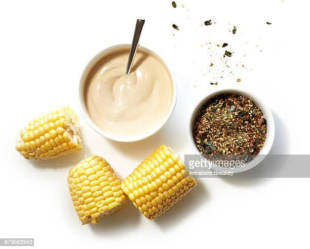 overhead of corn umami with mayo on white - corn on the cob bildbanksfoton och bilder