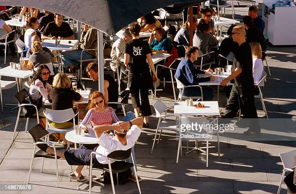 Overhead of diners at outdoor cafe, Federation Square.