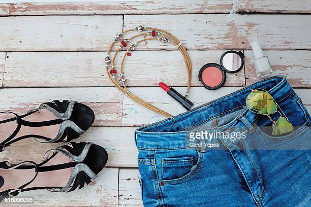Overhead of essentials of a modern woman. Above view to fashion stuff