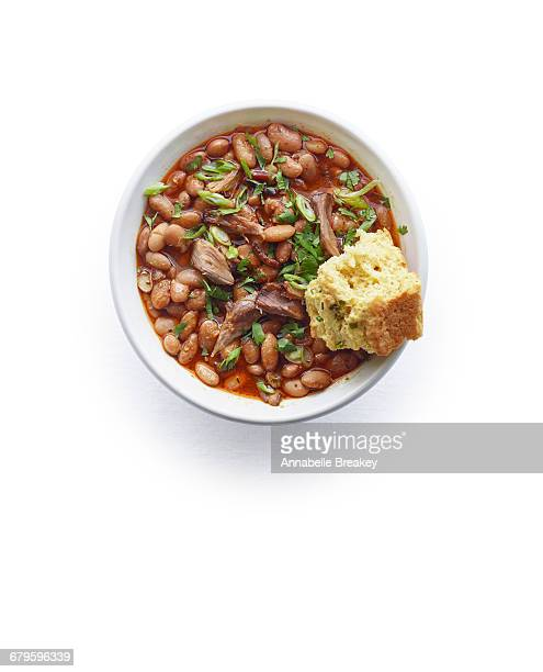 overhead of fat tire pinto beans with cornbread - pinto bean stock pictures, royalty-free photos & images