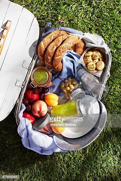 Overhead of full picnic basket on grass