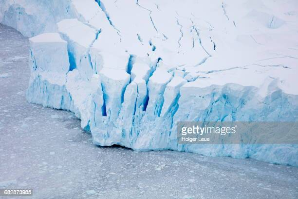 Overhead of glacier shelf with blue ice