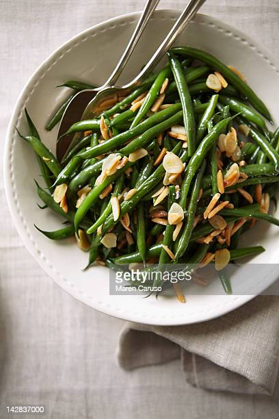Overhead of green bean dish with serving spoons