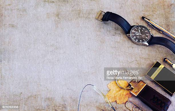 Overhead of men's accessories over abstract background. Copy space