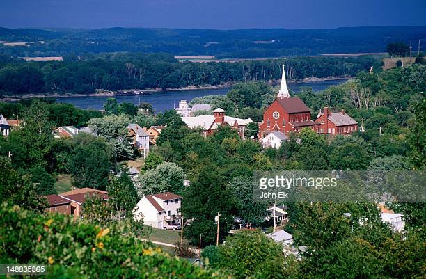 overhead of town buildings, trees and river. - missouri stock pictures, royalty-free photos & images