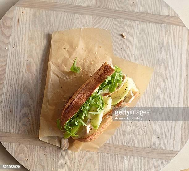 Overhead of turkey sandwich with apples & arugula