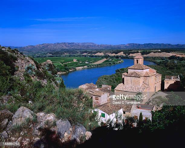 overhead of village and ebro river, miravet. - ebro river stock photos and pictures