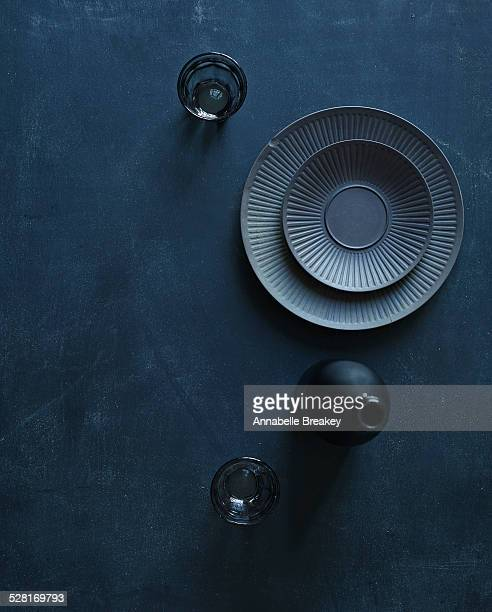 Overhead of Vintage Dishes on Dark Surface