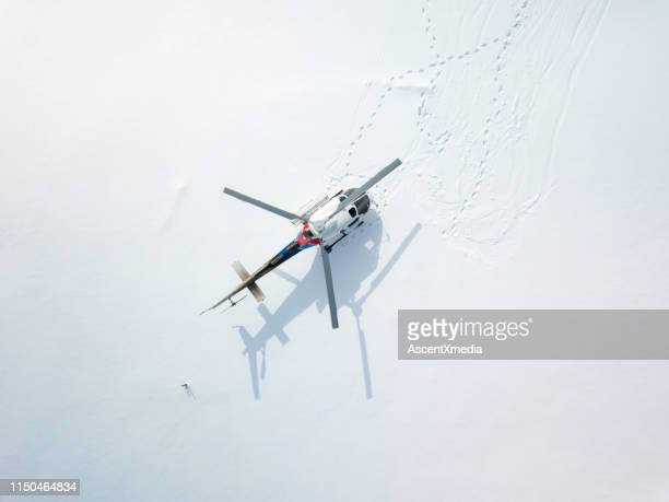 overhead perspective of helicopter parked on a snowy field - helicopter stock pictures, royalty-free photos & images