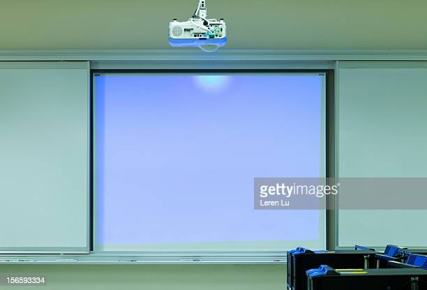 Overhead projector projects on white board