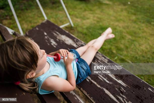Overhead shot of a girl child drinking water