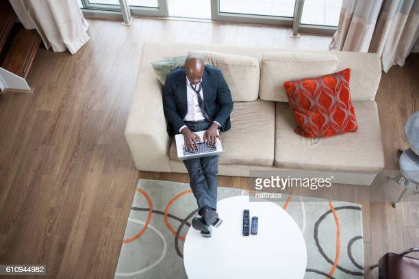 Overhead shot of a man working on a portable computer
