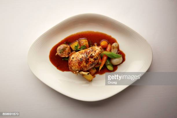 overhead shot of a plate of chicken and vegetables - gravy stock photos and pictures