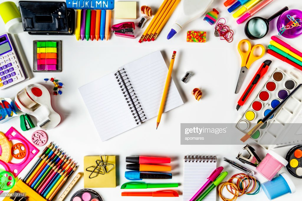 overhead shot of back to school office supplies on white