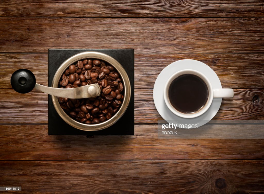 Overhead shot of Coffee Cup and Grinder on Wooden Background : Stock Photo