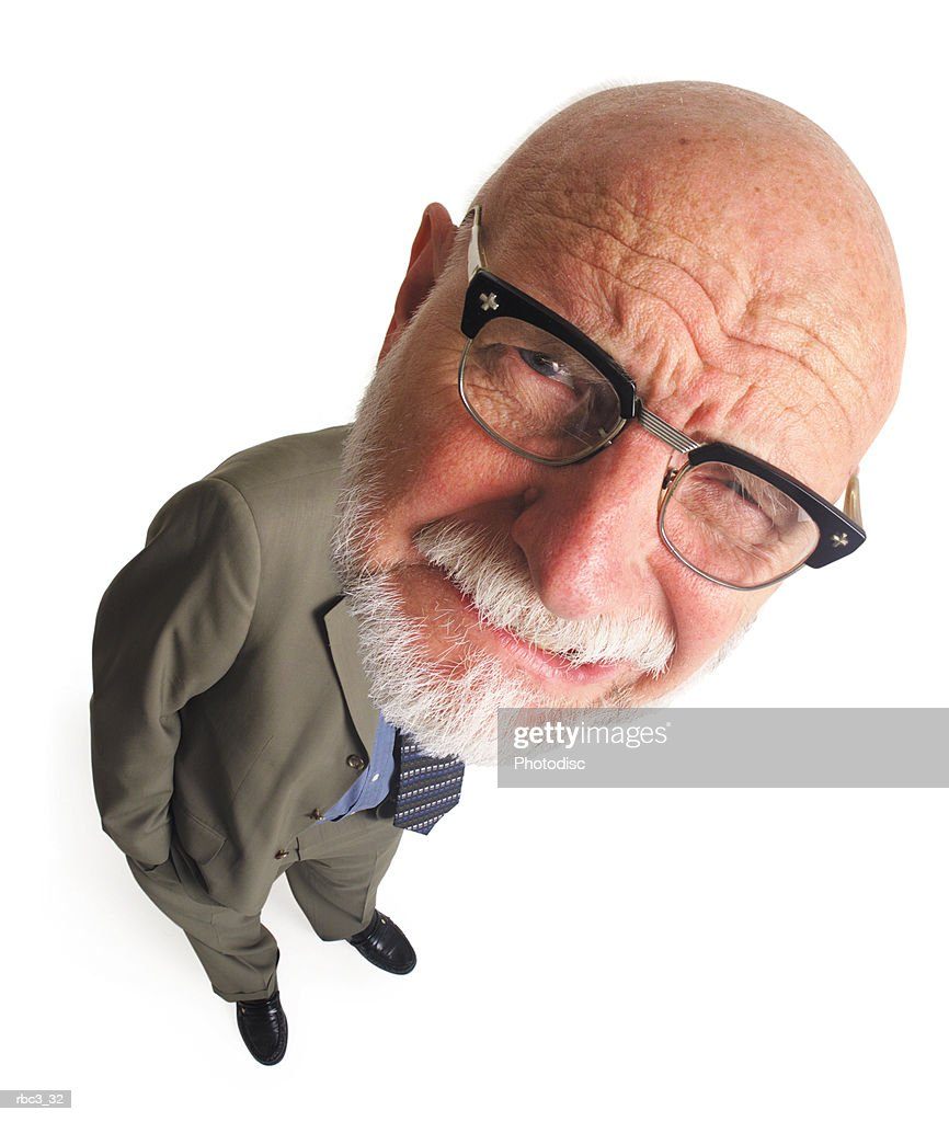 overhead shot of elderly bald business man with glasses leans to the side and grimaces into camera : Stockfoto