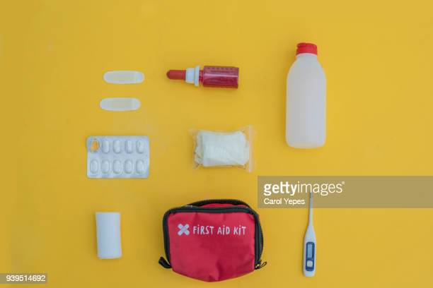 overhead shot of first aid kit - first aid kit stock pictures, royalty-free photos & images