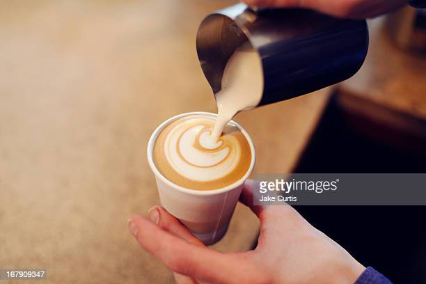 overhead shot of hand pouring coffee from jug