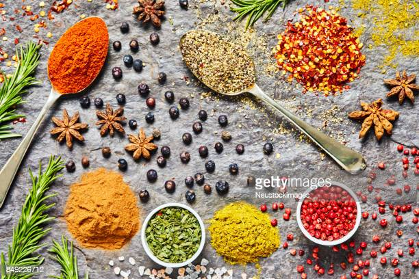 overhead shot of indian flavors and spices on slate background - garam masala stock photos and pictures
