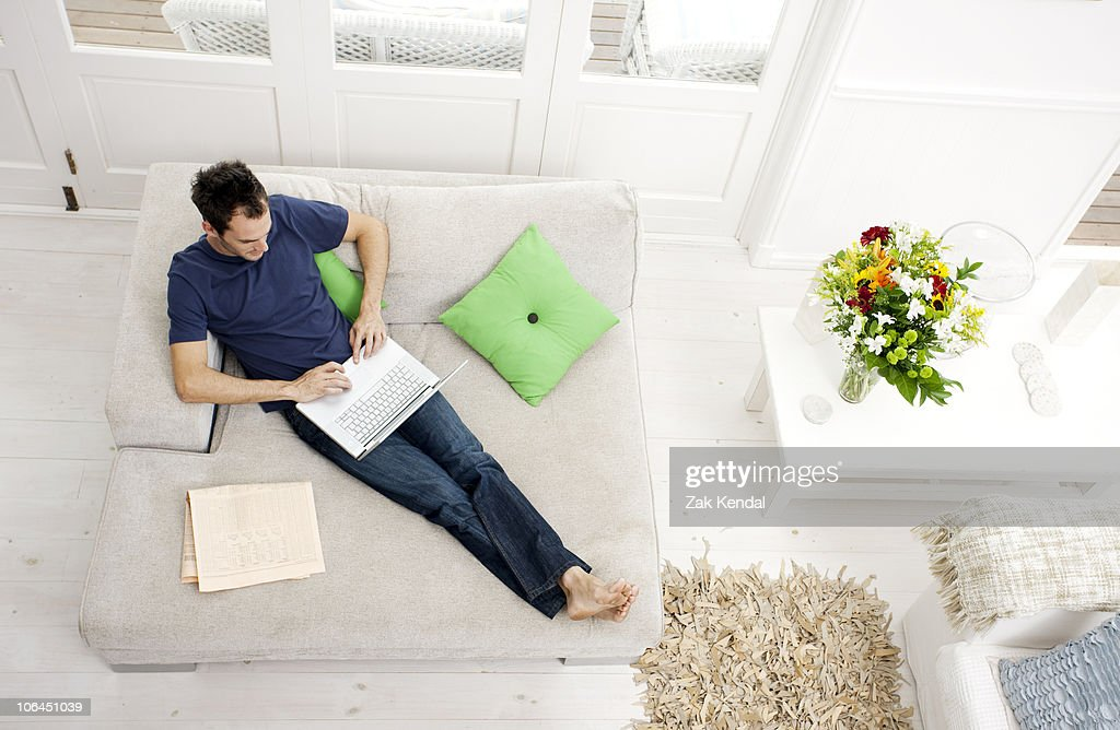 Overhead shot of man with laptop : Stock Photo
